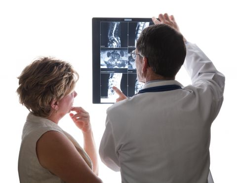Doctor and patient viewing an x-ray image