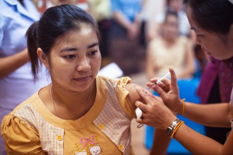 a girl receives a vaccination