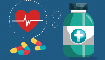 A pill bottle, pills and a healthy heart symbol